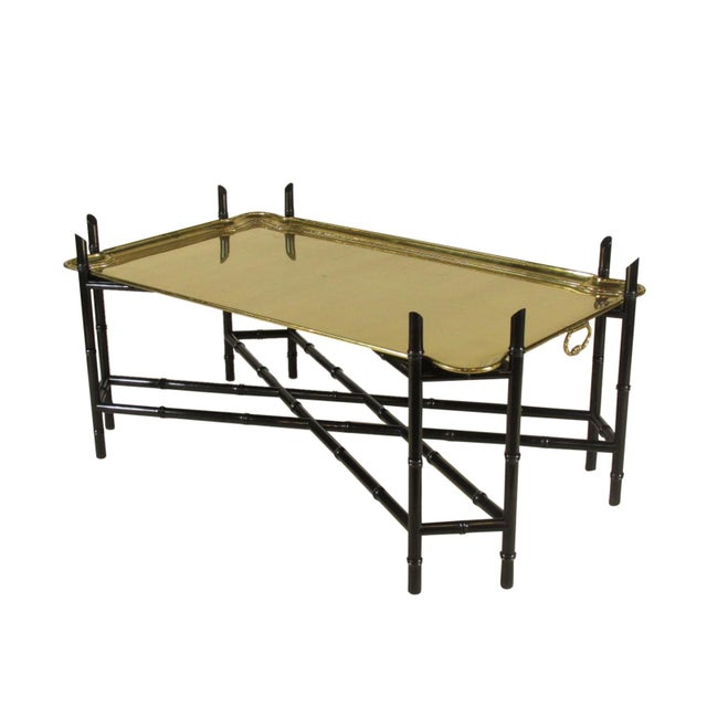 A vintage Regency-Style coffee table by Yale Burge N.Y., with original German made brass tray and black lacquer faux...
