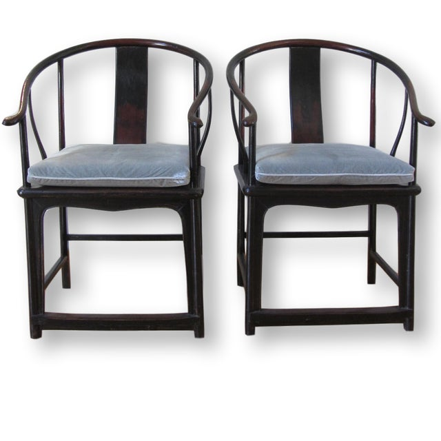 Pair of large antique Chinese horseshoe-back elm wood chairs from the Shanxi Province. Chairs have a smooth polished feel...