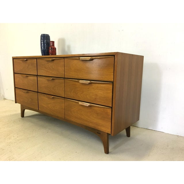 This walnut six-drawer dresser was made by the Johnson Carper furniture company which operated out of Roanoke, VA and was...