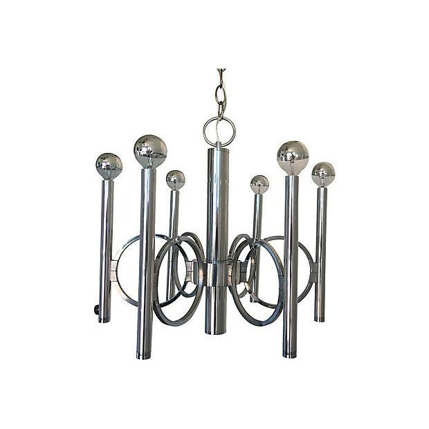 Stunning 1960s modern six-arm chandelier by Sciolari for Lightolier featuring concentric open rings on a polished chrome...