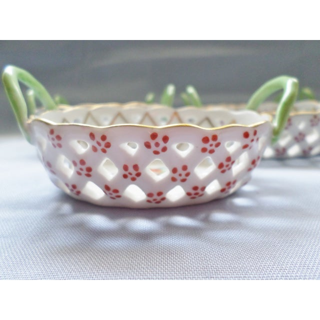 This is a Vintage Set of Eight Herend Hungary Lattice Baskets with a Cherry Design and Green Handles that have Cherry...