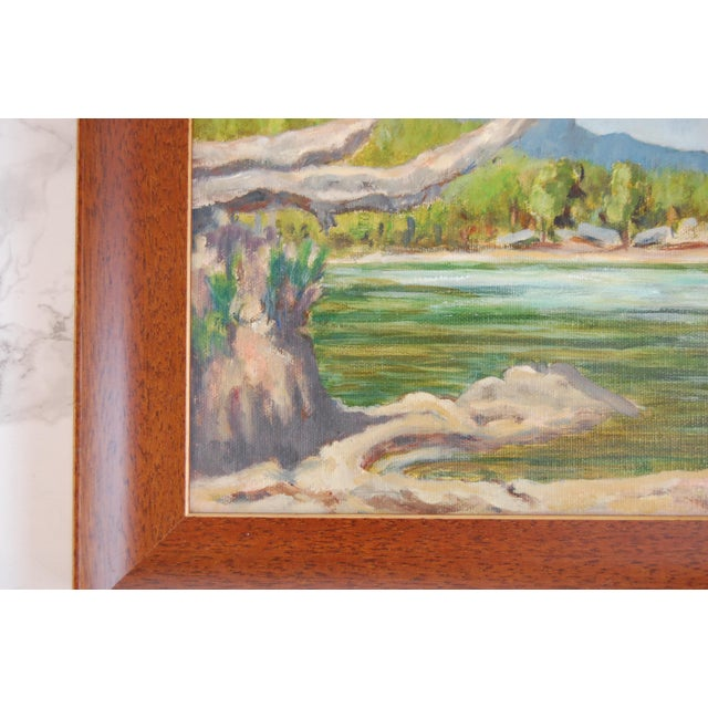 Vintage Oil on Canvas Lakeside Landscape, Signed This serene landscape painting features a calm waterfront. Mountains in...