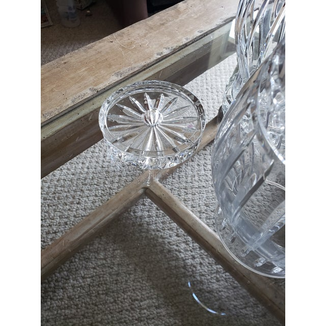 Gorgeous pair of matching cut crystal candleholders. Each takes a regular size tapered candle that will glisten from the...