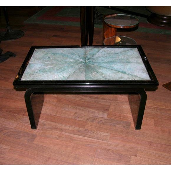 A beautiful French Art Deco occasional table, from circa 1935, made of ebonized laqured wood featuring a shagreen...