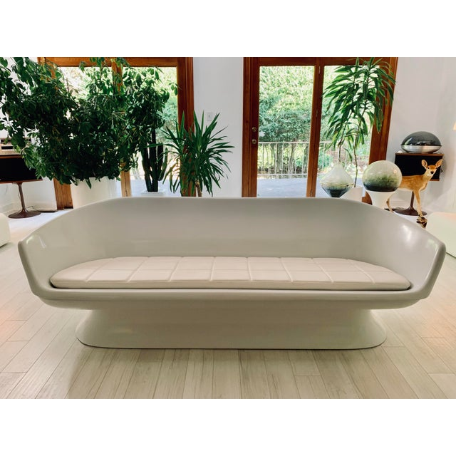 Chromcraft's fiberglass shell sofa. custom upholstery featuring a faux white leather and is cruelty free! The material...