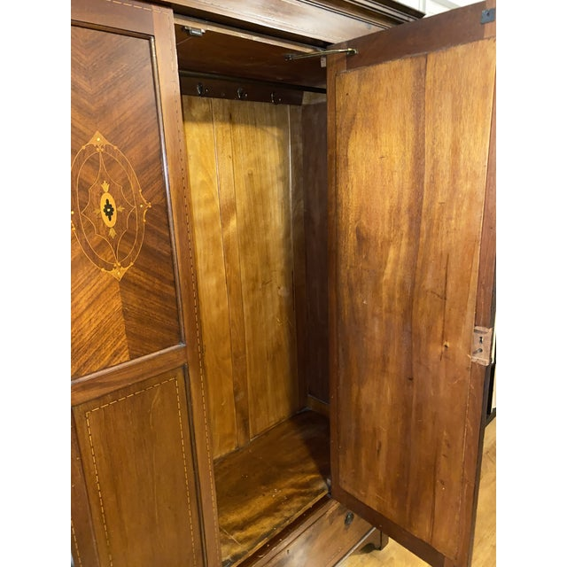 Edwardian wardrobe cabinet. Beautiful contrasting wood and mother of pearl inlays. Comes in three parts. Drawer/base,...