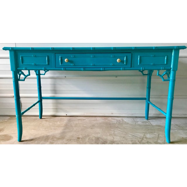 Professionally restored and lacquered makes this faux bamboo desk a standout piece.