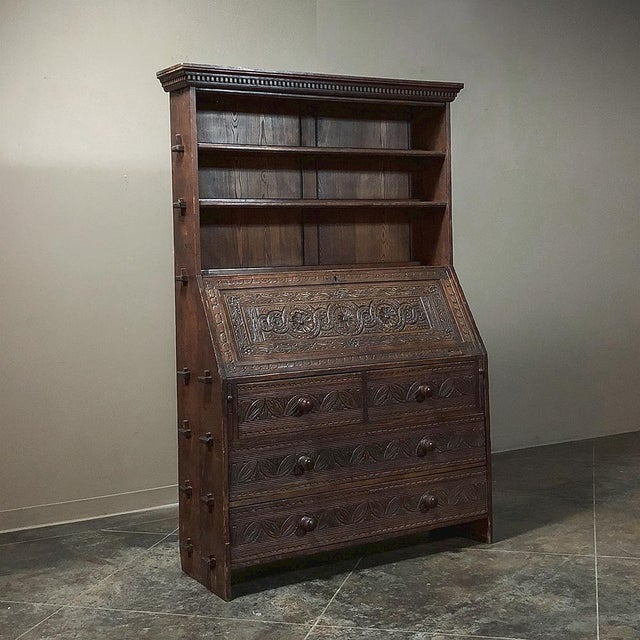 This exceptional 18th Century English Renaissance Secretary Bookcase displays wonderful rural craftsmanship from the crown...