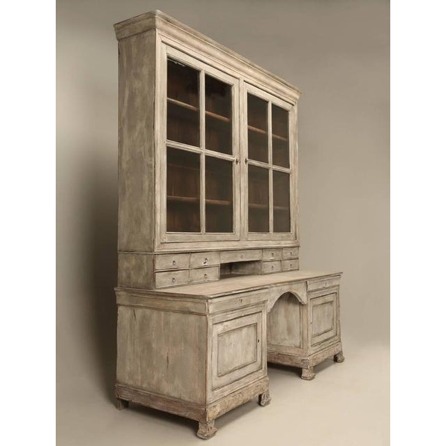 Antique French formal library bookcase from the Restauration period, that slotted between the Empire and Louis Philippe...