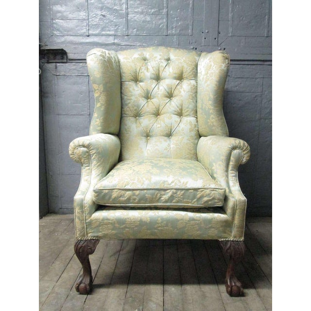 Pair of Chippendale style wingback chairs with ball-n-claw feet.