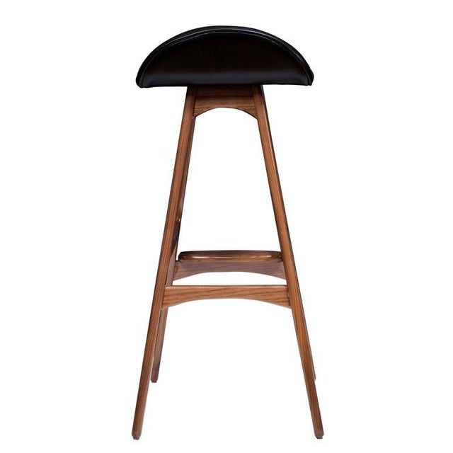 Boyd counter stool shown in solid walnut with black leather seat.