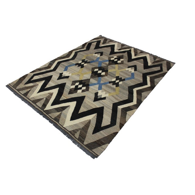 A beautiful modern kilim, handmade by Aara Rugs. It's a geometric design. This kilim is made of 100% wool, dyed with all...