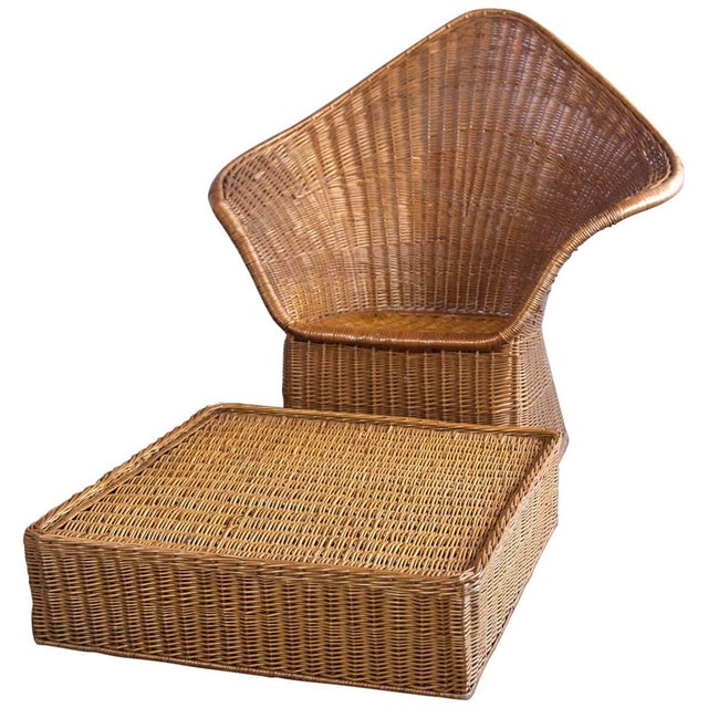"High drama! Unusual modern ""bat wing"" wicker armchair with large ottoman. Comfortable! Ottoman is 31 inches square, 9..."