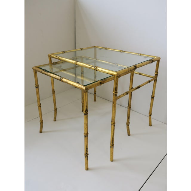 A beautiful set/pair of Mid-20th century Italian gold gilt metal and glass bamboo-esque nesting or end tables, circa...