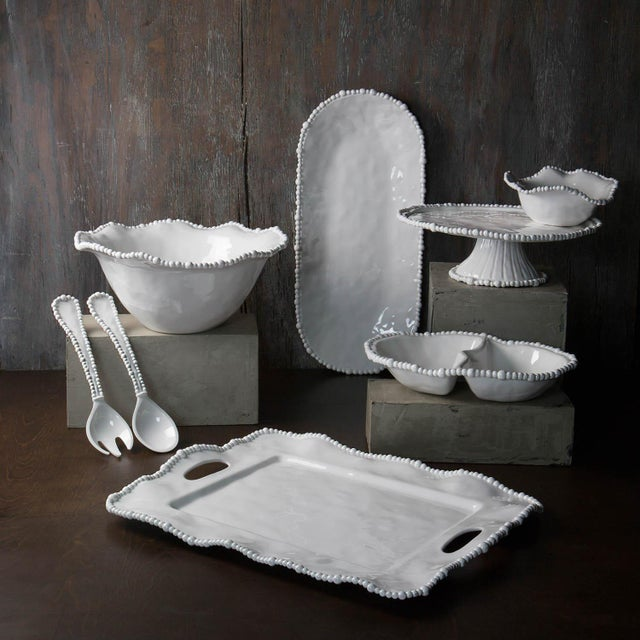 Melamine, reinvented. A brilliant white finish and pearl-rimmed styling make the Beatriz Ball Alegria Salad Servers the...