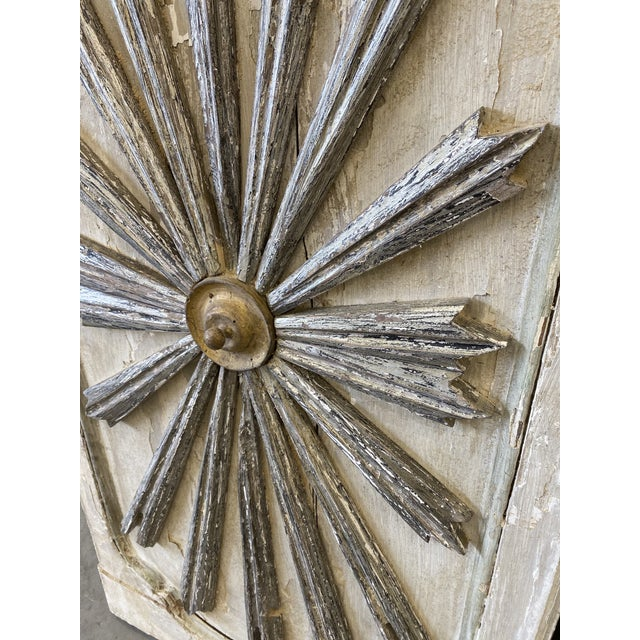 Lovely pair of 19th C Italian sunburst wall panels, featuring a cream background with silver tone rays and gilt sun...