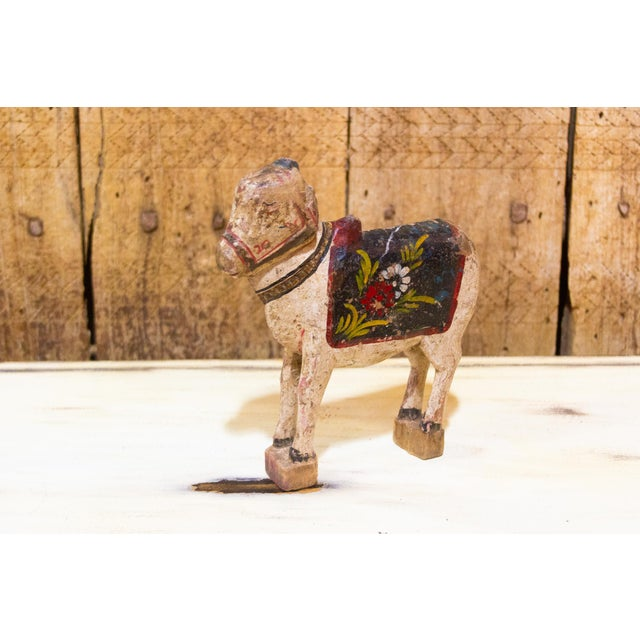 This charming statue is hand-carved from wood, its hand painted in lively traditional Indian colors and stands on two...