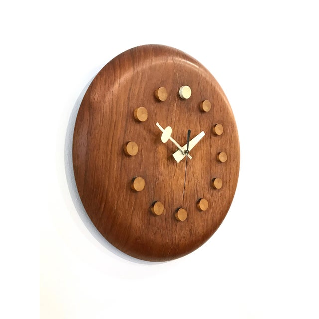 Molded teak wall clock, model 7512, by George Nelson & Assoc. and Fritz Hansen for Howard Miller, USA, 1957 14 x 1.5 x 13 in