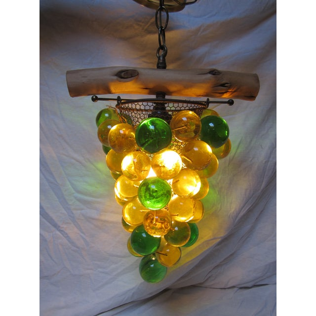 This green and yellow acrylic grape cluster ceiling light would be a perfect addition to anyone's wine gallery, garden...