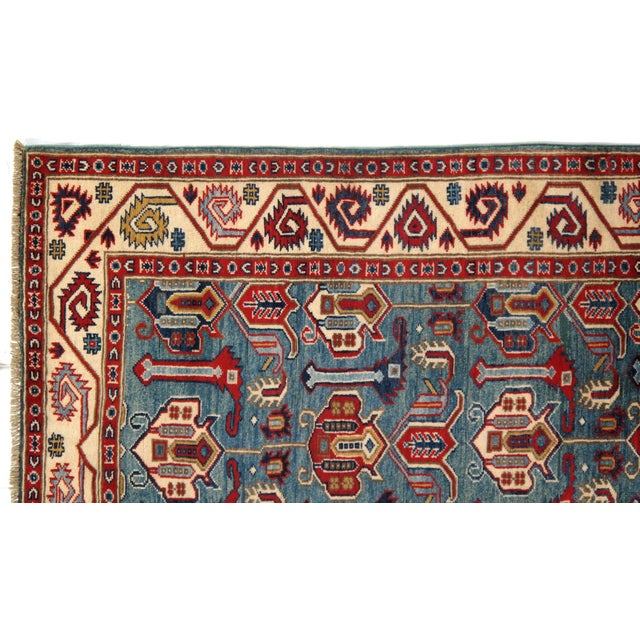 Original Kazak design rug made from hand-spun lamb's wool on a cotton foundation. This rug is handmade from 100-percent...