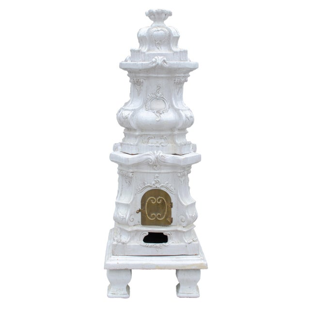 Eight pieces; flamed finial above serpentine and bombe sections modeled with acanthus and scrolling foliage rocaille...
