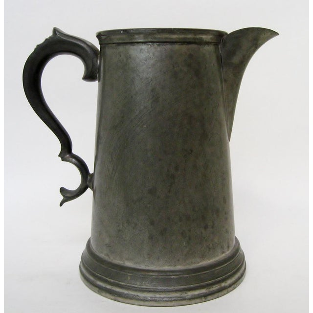 Sheffield 1980s pewter pitcher with ornate handle, made in England, exclusively for Saks Fifth Avenue. Maker's mark on...