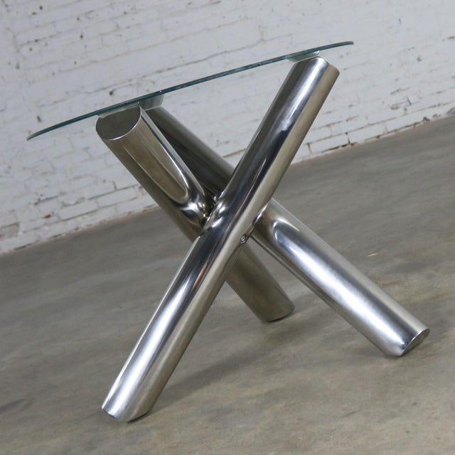Incredible stainless-steel jacks shaped or tripod end table or side table with a round glass top done in the style of Milo...