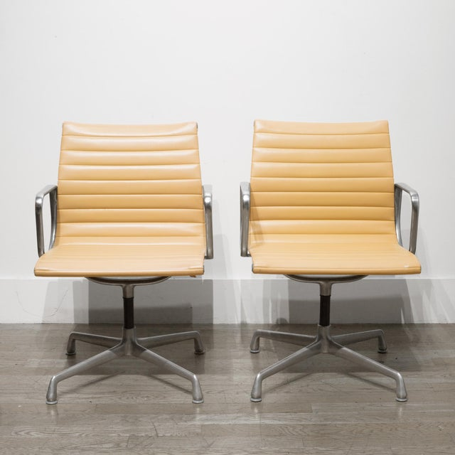 ABOUT Price is per chair. A set of four vintage Herman Miller EA108 swivel office management chairs in butterscotch...