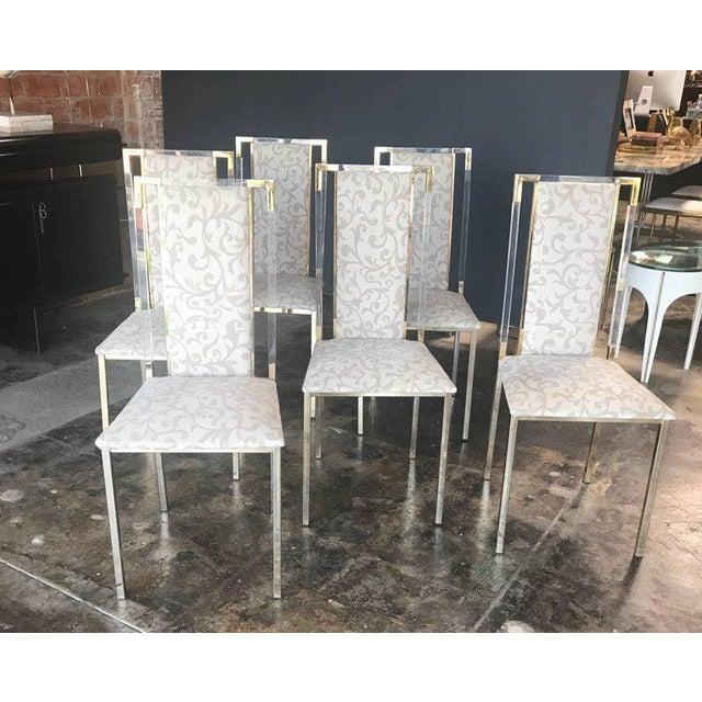 Italian 1960s set of six chairs in brass and plexiglass.