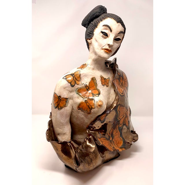 Vintage ceramic sculpture depicting a Japanese woman by Northern California artist Theo Samuels. A very striking piece...