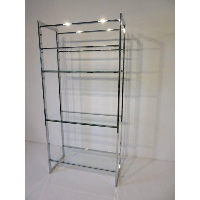 A five chrome and glass shelved etagere in the manner of Milo Baughman with over sized middle area for larger sculptures...