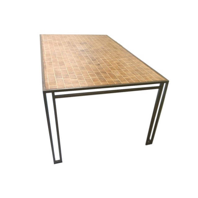 This 1970s dining table was designed by American interior decorator Billy Baldwin. It is comprised of an iron base and...