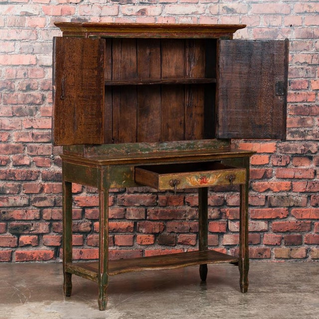 This delightful step back cabinet, while small in size, is brimming with character. Adding to its charm is the distressed...