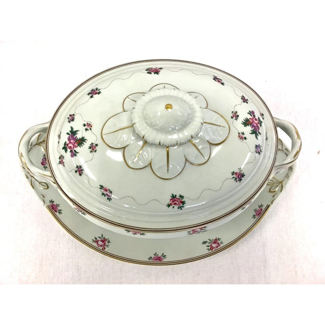 A beautiful porcelain 3 pc. soup tureen with lid and underplate by Mottahedeh. Hand-painted with delicate roses and gold...