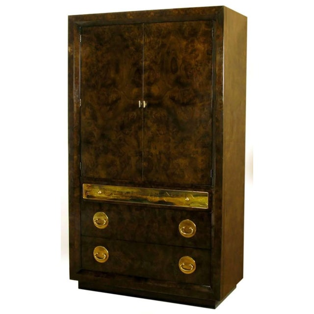 Mastercraft burl amboyna wood tall wardrobe cabinet. Three drawers in the base with top drawer faced with an acid etched...