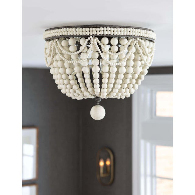 Classic style meets modern charm with this flush mount. A bevy of draped wooden beads in weathered white, dresses up the...