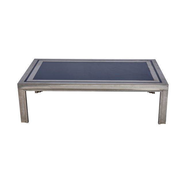 This Midcentury French steel with navy enamel top coffee table is chic and substantial. Since Schumacher was founded in...
