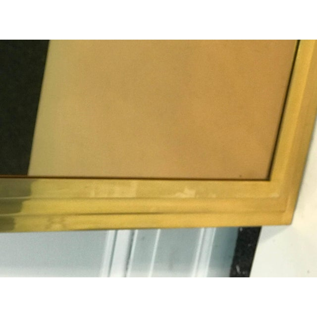 Great modern triple-tiered gold plated steel mirror designed in the 1970s.Heavy and substantial construction with...