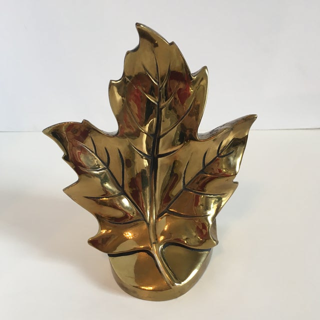 A gorgeous bookend in the form of a leaf. This single bookend can be used as it was intended, or as an accent piece....