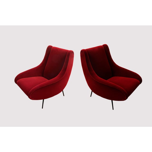 Pair of vintage style BOND Design Studio armchairs re-upholstered in a hardy and plush red velvet. Black solid steel base...