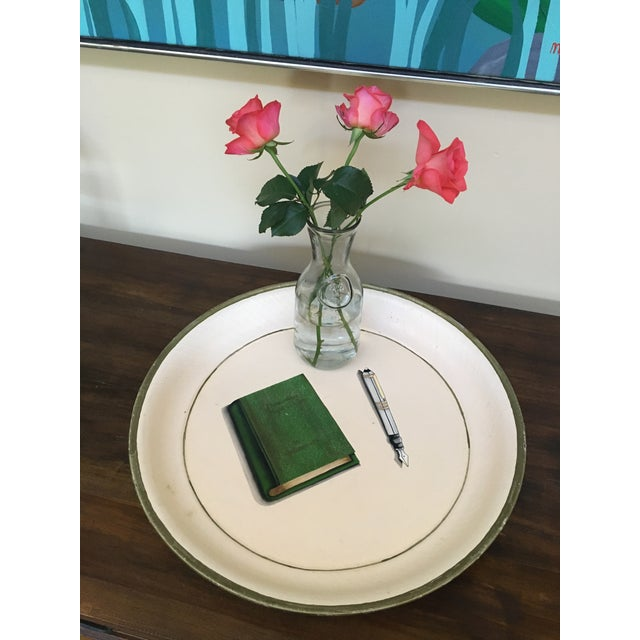 One-of-a-kind, large white circular painted metal tray with a high, two-inch lip. This entirely hand painted, signed,...