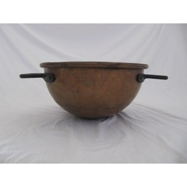 "Huge antique copper candy/fudge/apple butter cauldron with iron handles. Measures 23""L (handle to handle) x 17Wx 8.5H."