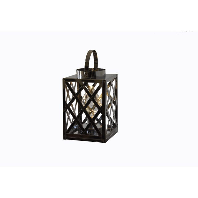 This Lantern Silver Cube will be a perfect addition to your home and will bring peace and harmony. The Bulbs is included....