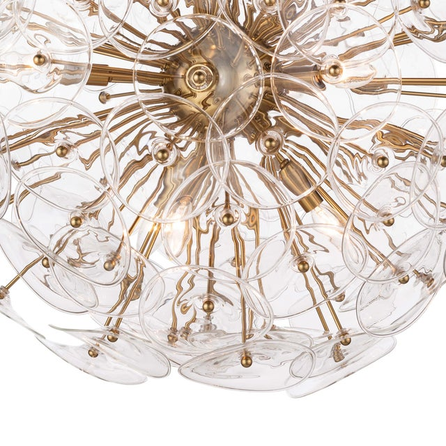 Create a glamorous modern statement in your dining room or master bath with Poppy, a stunning sputnik-style orb...