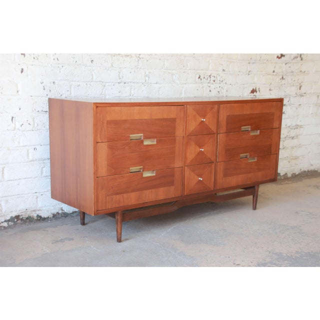 Offering a nice mid-century modern dresser or credenza by Merton Gershun for American of Martinsville. The dresser offers...