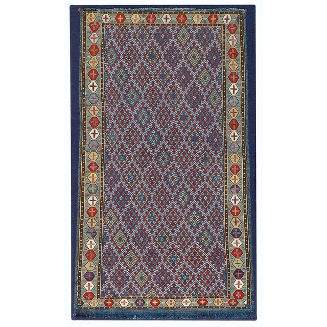 "This finely executed silk ""zilleh"" employs a supplemental weft all-over diamond pattern against a flatwoven tapestry-weave..."