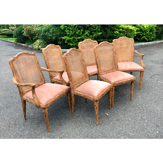 Dramatic carved detail on these stunning faux bois chairs, circa mid century. Sophisticated lines, hand crafted. Original...