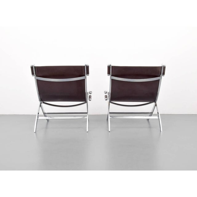 Gorgeous leather and chrome lounge chairs by Flexform ITALY