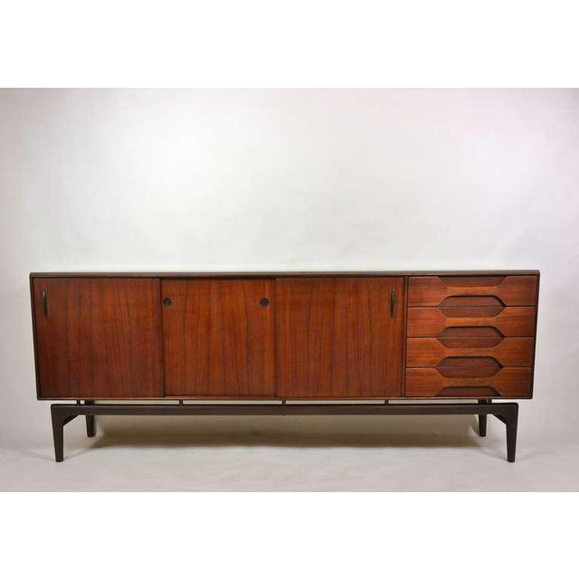 Teak and rosewood credenza by Arne Hovmand-Olsen for Mogens Kold. Teak cabinet with four drawers and sliding doors...