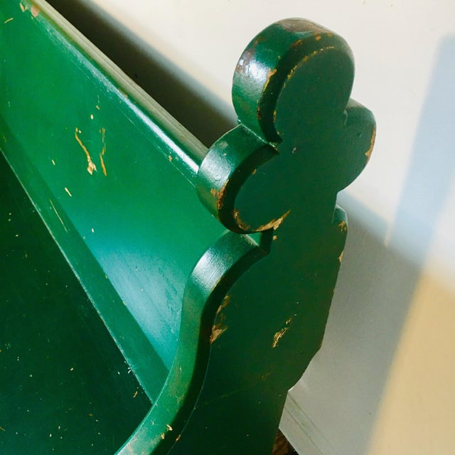 Charming Victorian Gothic style pew from a church here in Baltimore. The emerald green paint is naturally distressed. The...